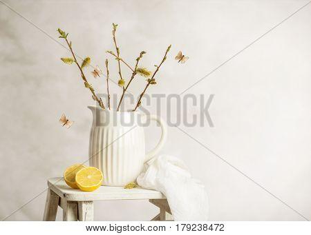 Spring still life with jug of catkin sprigs on step ladder