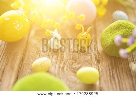 Rabbits With Easter Eggs On Wooden Table. Cute Little Easter Bunny. Happy Easter