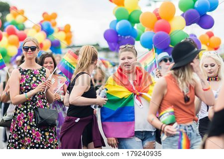 Stockholm, Sweden – July 30, 2016: Women Holding Rainbow Flags And Balloons During Stockholm Pride P