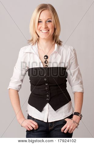 Laughing young blond girl with a shirt and a vest