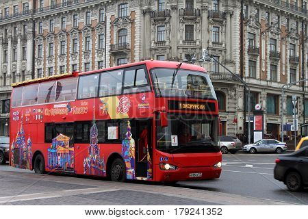 MOSCOW - MARCH 07 2017: Red tourist bus on the front of the hotel National in Moscow. Russia.