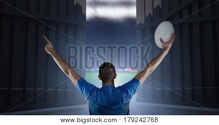 Rear view of rugby player holding ball with arms raised against football pitch with world cup flags 3d