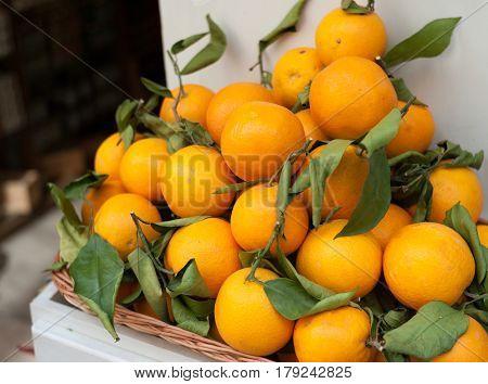 Fine ripe oranges in basket