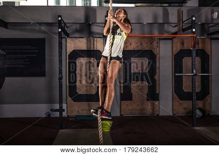 Fitness rope climb cxercise In gym. Healthy lifestyle