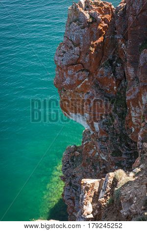 Cliffs and amazing green waters of the deepest lake Baikal, Olkhon island, Russia