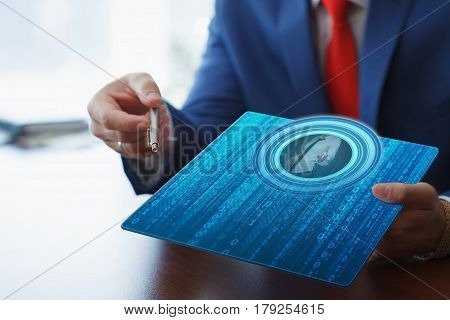 Business, Technology, Internet And Network Concept. Young Businesswoman Working On Her Tablet In The