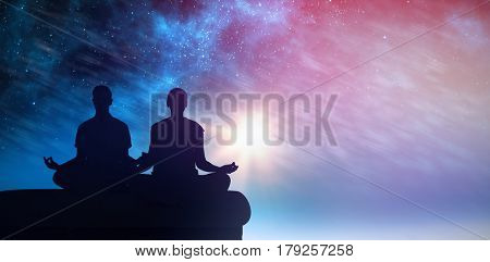 Attractive couple in white meditating in lotus pose against aurora night sky in blue