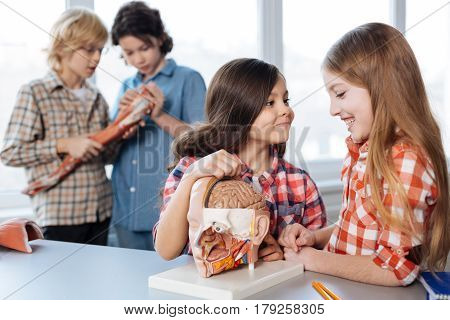 What is your favorite thing about it. Groups of curious clever children exchanging thoughts about class while spending it in lab examining human body prototypes