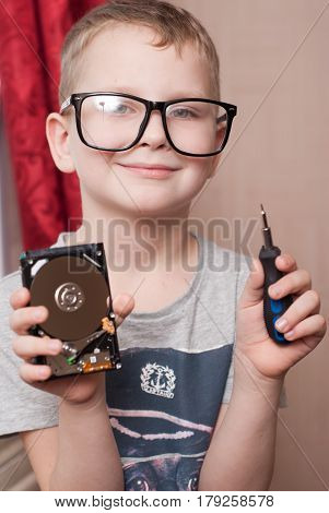 Little Boy In Big Glasses, Smart, Student, Examines A Hard Disk, A Boy With A Screwdriver,