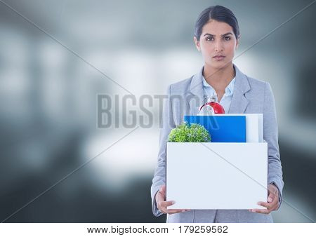 Digital composite of Sad woman redundant with box of office job equipment