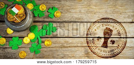 Composite image of St Patrick Day with beer glass symbol against composite image of shamrock, coins and irish flag