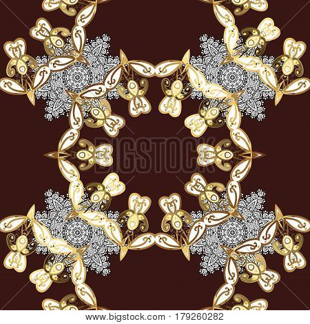 Patina. Pattern on brown background with golden elements. Carving. Small depth of field. Furniture in classic style. Seamless element woodcarving. Brown tree with gold trim. Luxury furniture.
