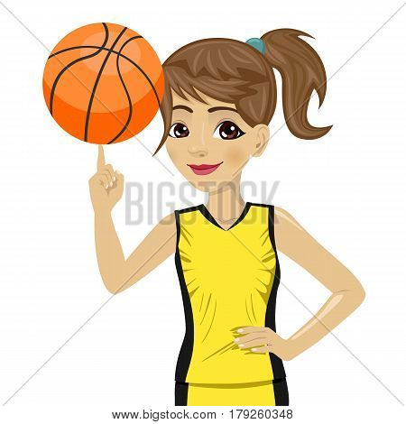 teenager girl spinning basketball ball with her finger on white background