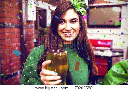 Flying colours against portrait of smiling woman holding a green pint 3d
