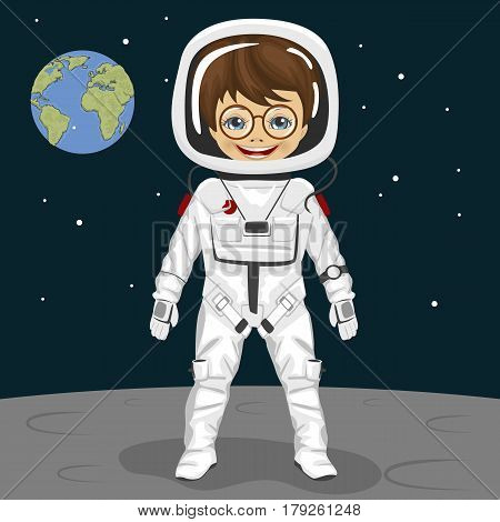 Little nerd boy astronaut standing on the moon surface on the backround of earth