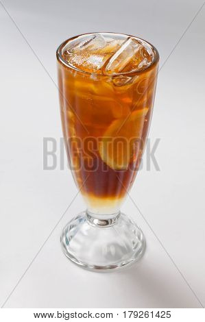Cold Tea With Lemon And Ice In The Glass.