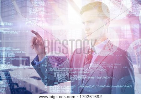 Young smart businessman pointing against interior of empty office 3d