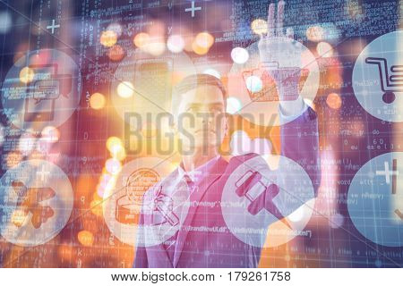 Young sophisticated businessman gesturing against glowing road in city at night 3d