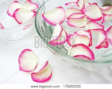 spa bowls with clean waterwith rose petals