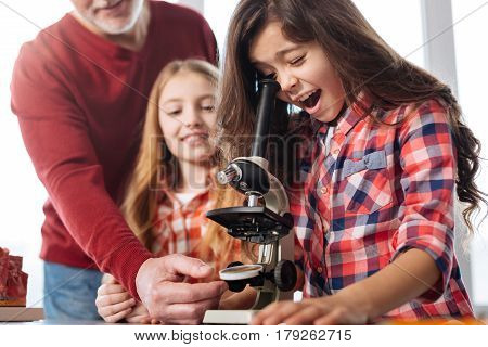 Are those even real. Brilliant bright talented student being excited about using a microscope while attending biology class in lab