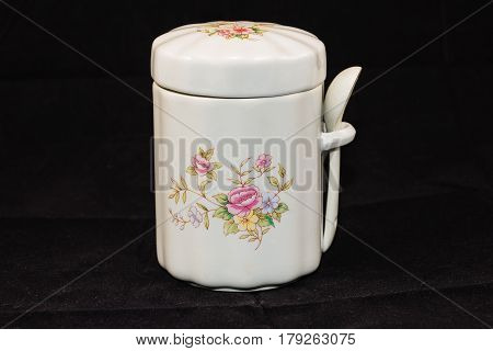 jar for storing tea or sugar (five and a half inches tall, 3 and a half wide)