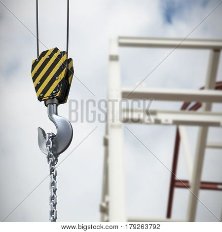 Studio Shoot of a crane lifting hook against low angle view of scaffolding against cloudy sky