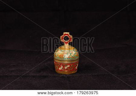 small brass bell 5 (two inches high, one and a half wide)