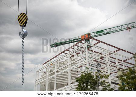 Studio Shoot of a crane lifting hook against crane at construction site
