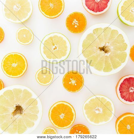 Lemon, orange, mandarin, grapefruit and sweetie on white background. Flat lay, top view.