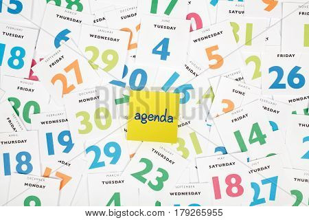 Calendar pieces, one piece with text agenda. Planning and time management concept. Top view.