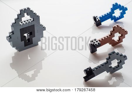 Lock and different keys on white background. The choice of three keys the selection of the key to the lock.