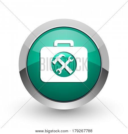 Toolkit silver metallic chrome web design green round internet icon with shadow on white background.