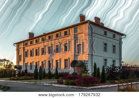 the paradise house in the old Christian monastery against the background of the unreal sky