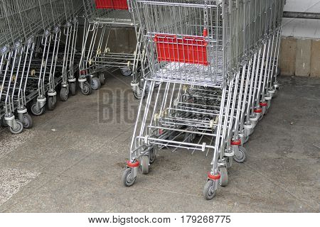 a row of stocked shopping trolleys outdoor