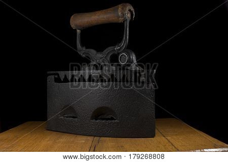 Vintage clothes charcoal iron ,still-life, isolated on wood table