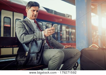 Portrait of a businessman in a train station.