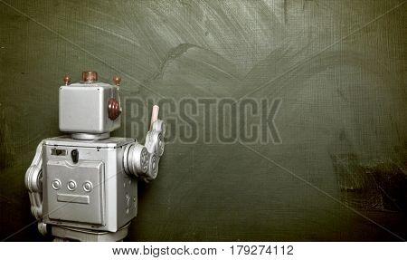 vintage robot writes on black board