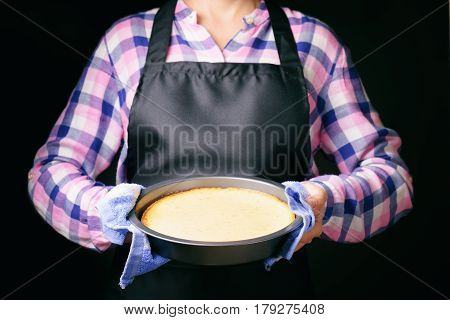 Freshly Baked Cheesecake In Hands Of Woman