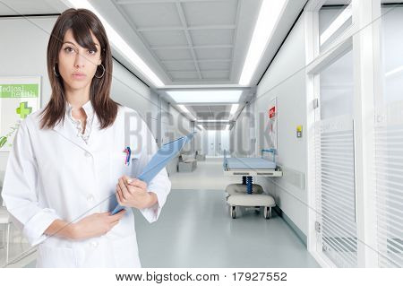 Young nurse standing by a hospital corridor