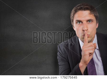 Digital composite of Business man finger over mouth against concrete wall