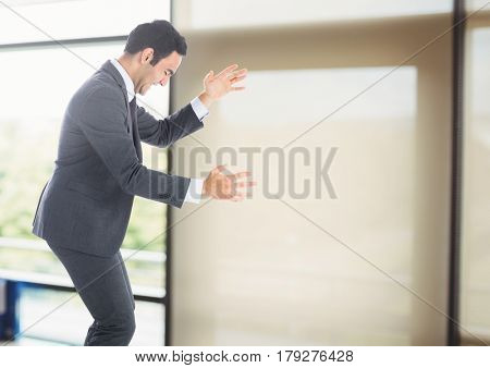 Digital composite of Businessman dancing happy celebrating by windows