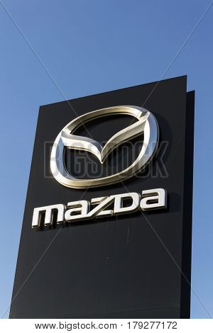 Prague, Czech Republic - March 31: Mazda Car Company Logo In Front Of Dealership Building On March 3