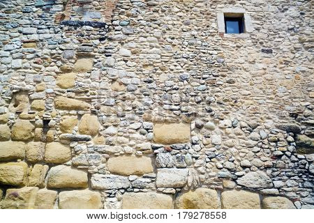 Old brick stone wall with smal window