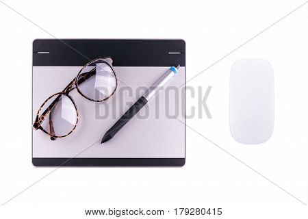Top view of graphic tablet with pen and retro glass and wireless computer mouse isolated on white background. For illustrators photographer and designers tools concept