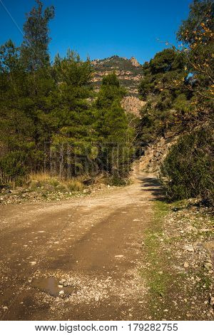 Landscape with unsurfaced road in Vouraikos gourge, Peloponnese, Greece