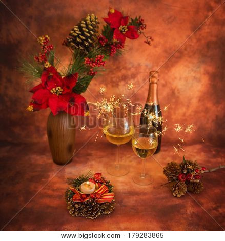 Christmas Still Life With Sparklers, Ornaments, Champagne And Candle