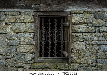 The Stone Wall And Window Of An Old Farmhouse
