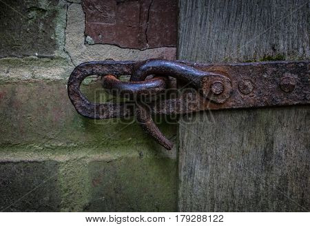 The Iron Latch On A Wooden Door