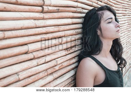 Beautiful Girl. The Girl On The Bamboo Background