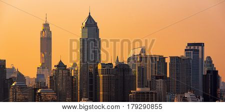 Panorama view of modern office buildings condominium in big city downtown with sunset sky